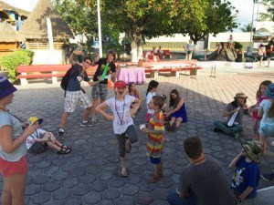 A group of people in a 'circle' playing poison frog.