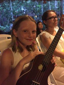 Me, holding my teachers ukulele.